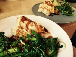 Pan-fried chicken breasts with Asian greens and oyster sauce