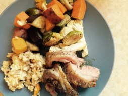 Lamb roast with risotto and roasted vegetables.
