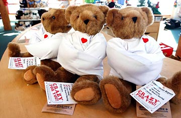Crazy for you teddy bear, wearing a straightjacket.