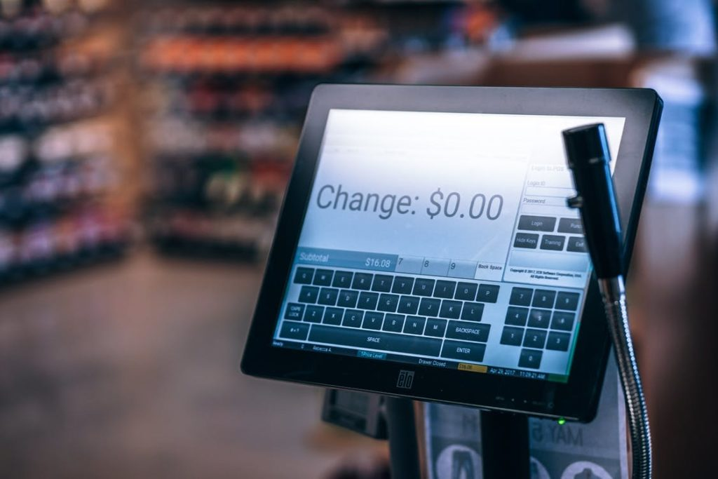 "Computer touch screen cash register. Text ""Change $1.00"""