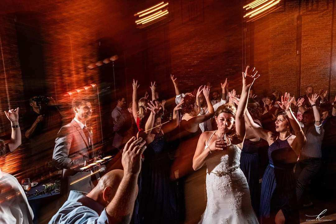 Bride Raises Hand and Parties