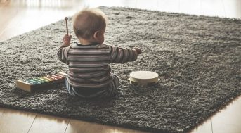 Young child making music in early childhood education