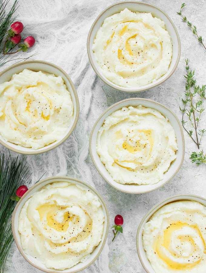 Single serving bowls of Roasted Garlic Mashed Potatoes