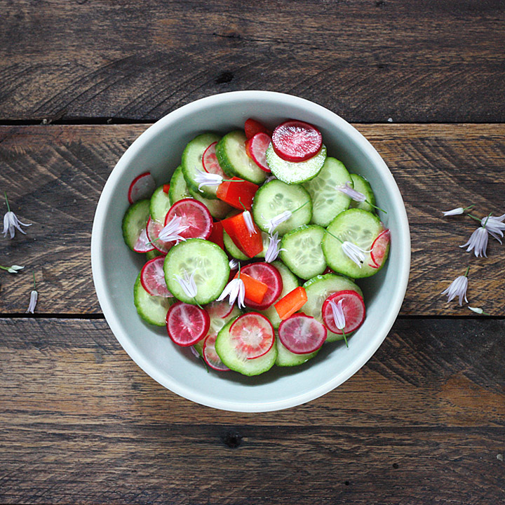 Chive Flower Cucumber Salad in a bowl