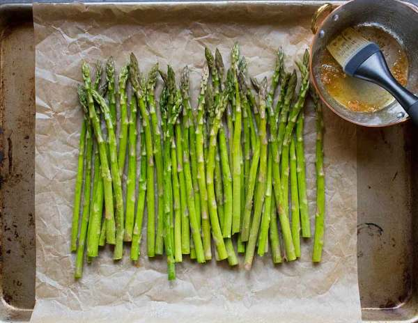 Fresh spring asparagus, ready to be brushed with miso butter and roasted.