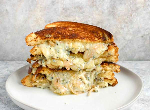 Ultimate grilled cheese sandwich on a plate