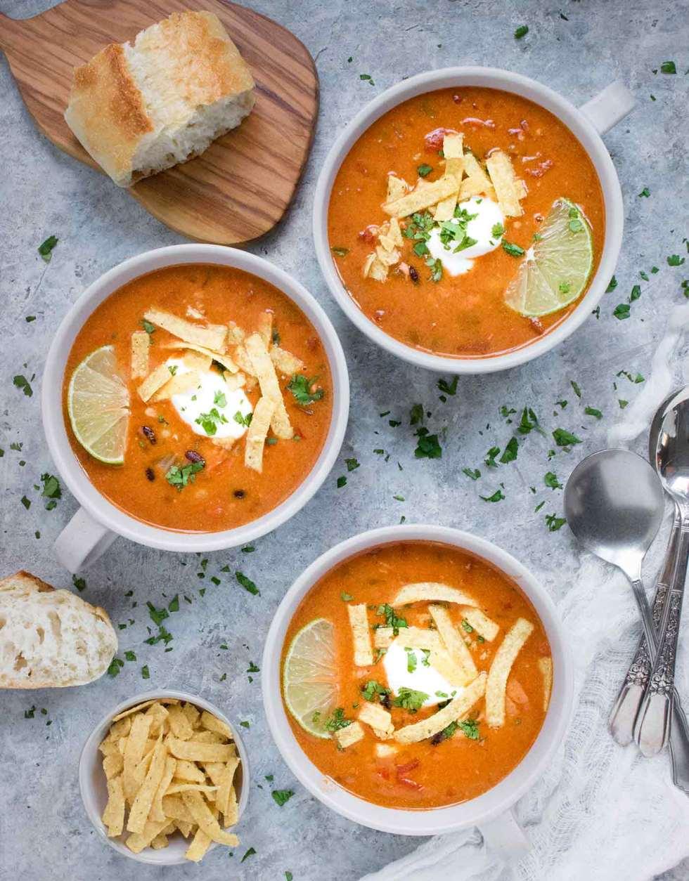 Three bowls of Instant Pot Chicken Tortilla Soup