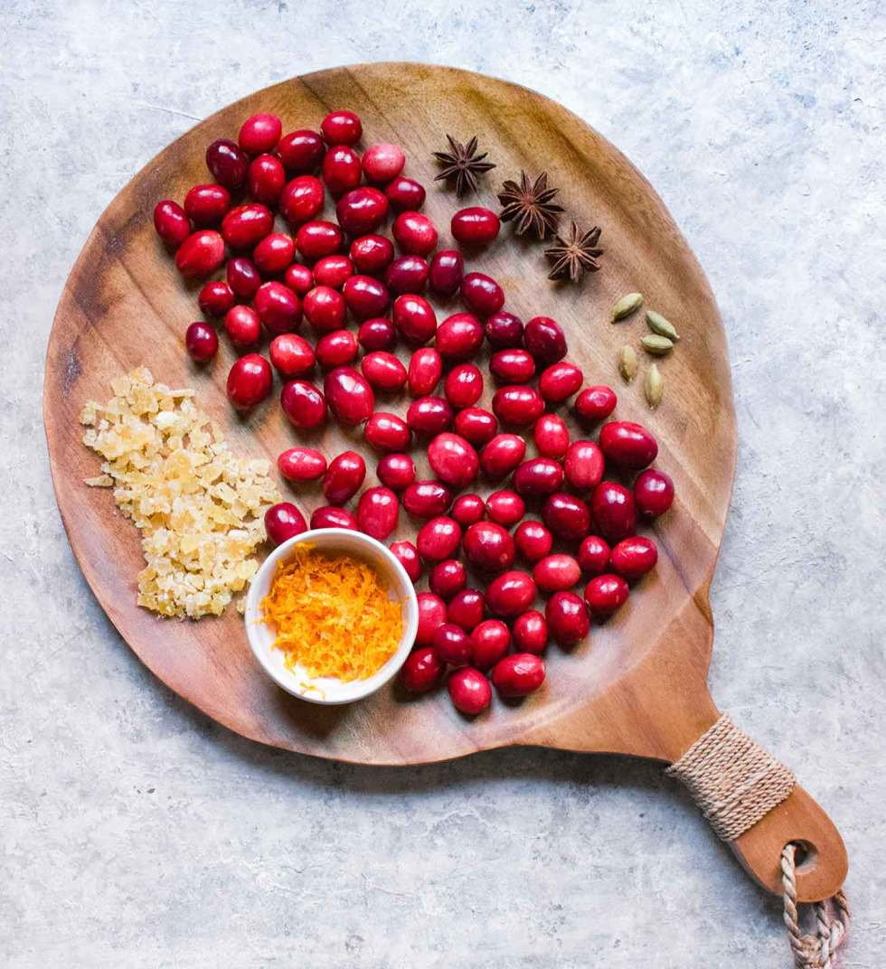 Ingredients for Instant Pot Spiced Cranberry Sauce on a serving board