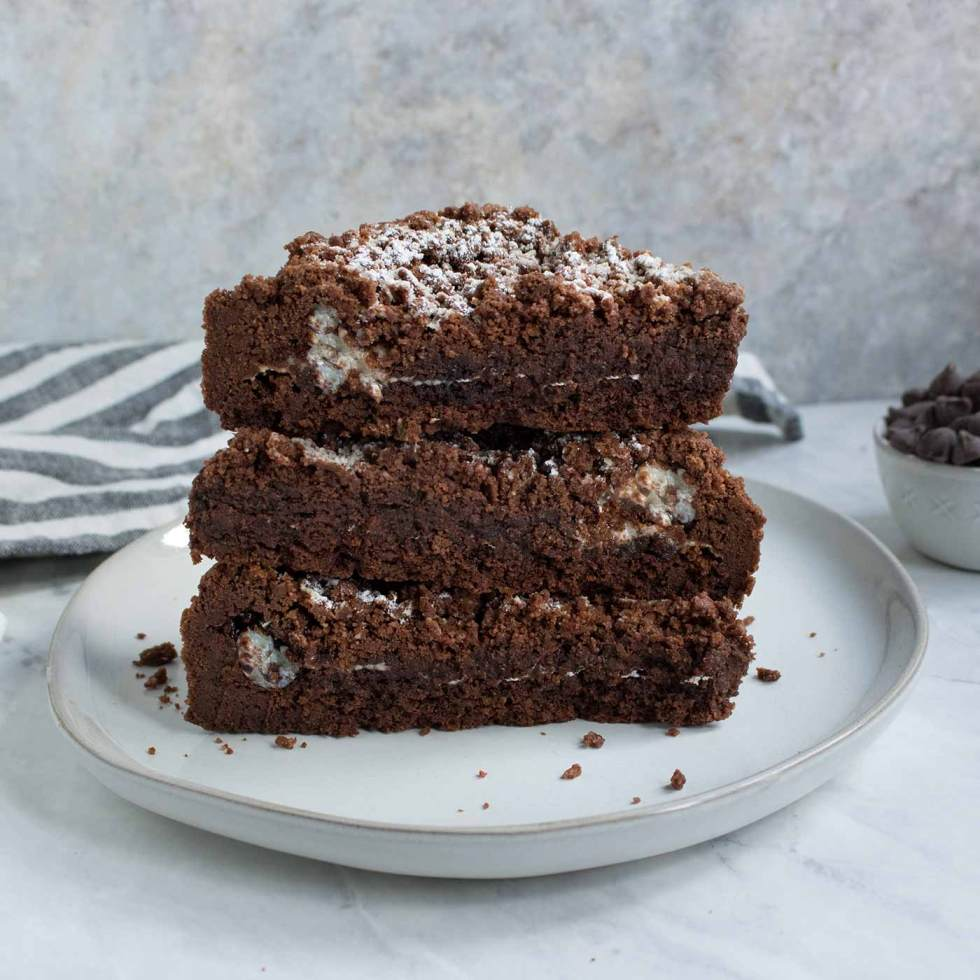 Chocolate Marshmallow Shortbread Bars stacked on a plate