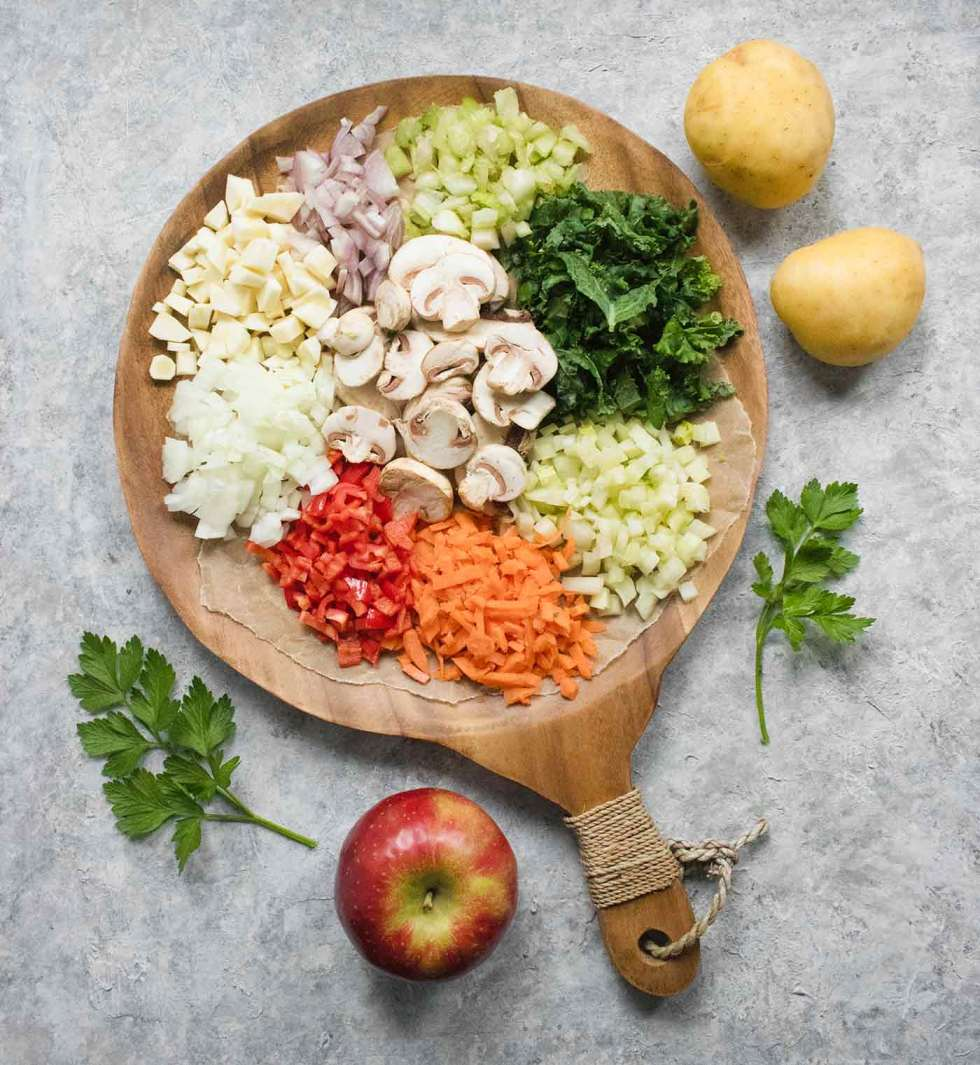 Ingredients on a wooden board for Hearty Vegetable Wild Rice Soup