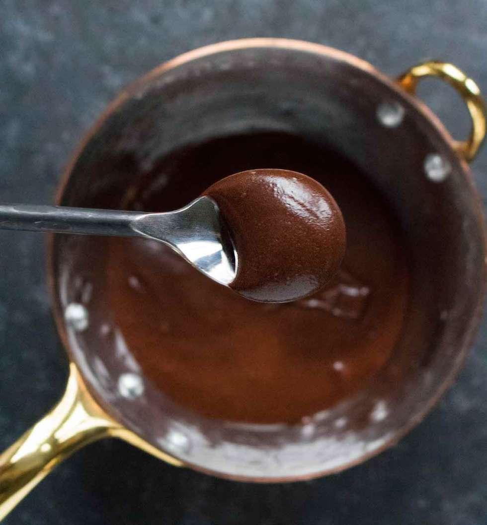 Vegan chocolate glaze in a copper pot