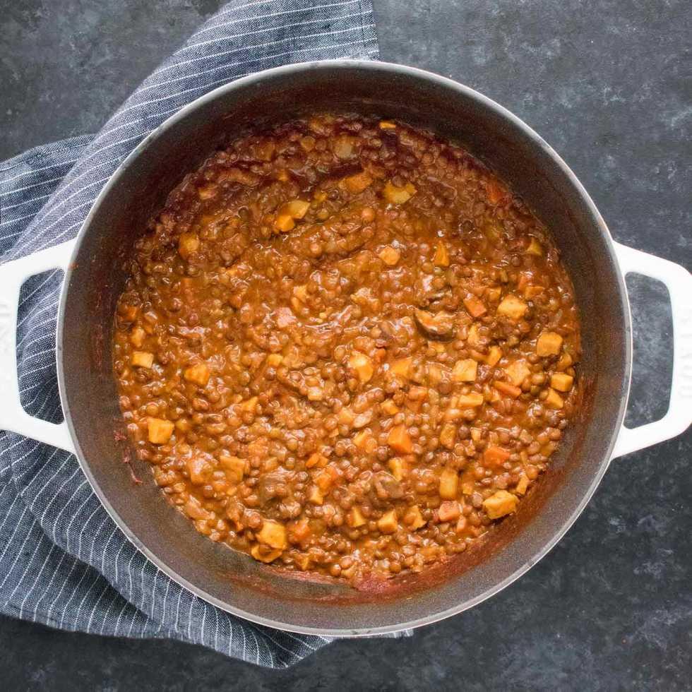 Vegan Irish Stew in a white Dutch oven, ready to serve