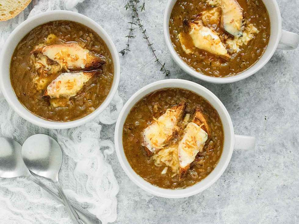 Three bowls of Guinness Onion Soup topped with Irish Cheddar toast points