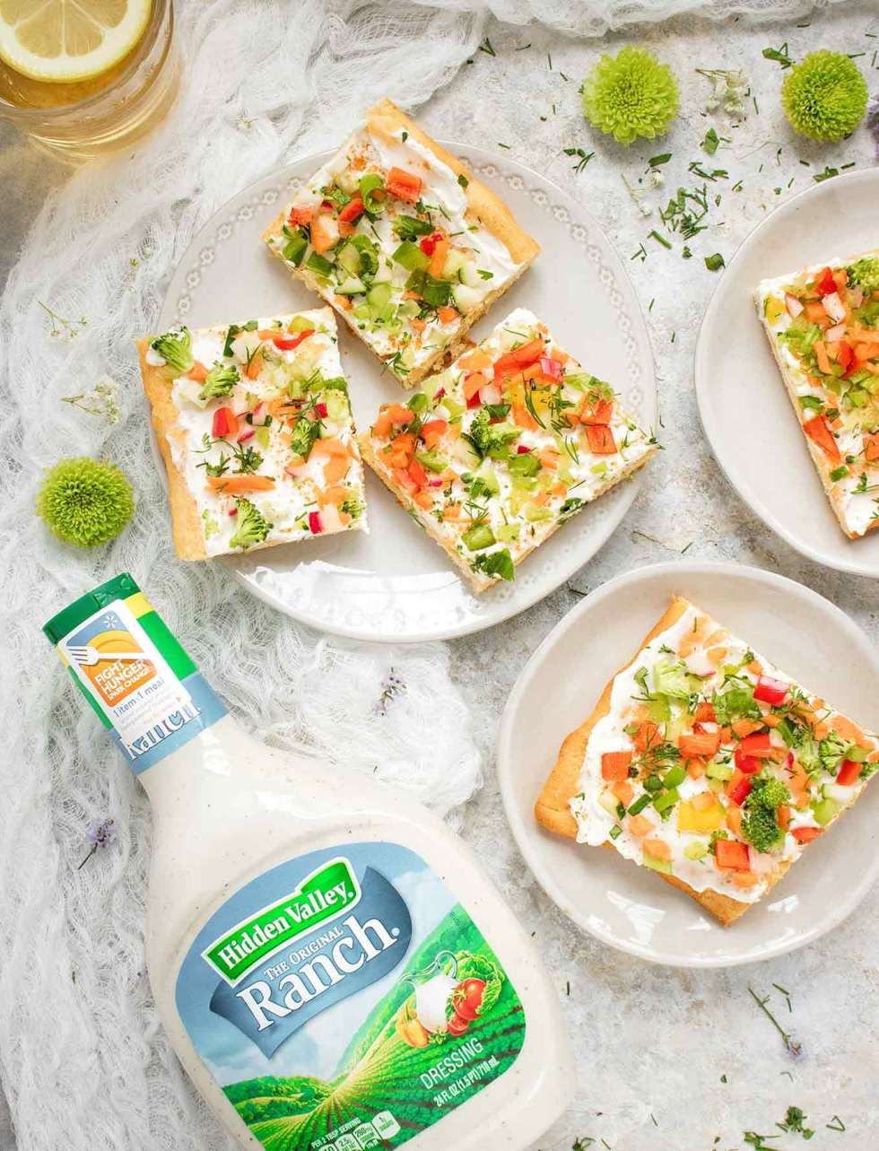 Ranch Veggie Pizza Appetizer served on plates, next to a bottle of Hidden Valley Ranch Dressing
