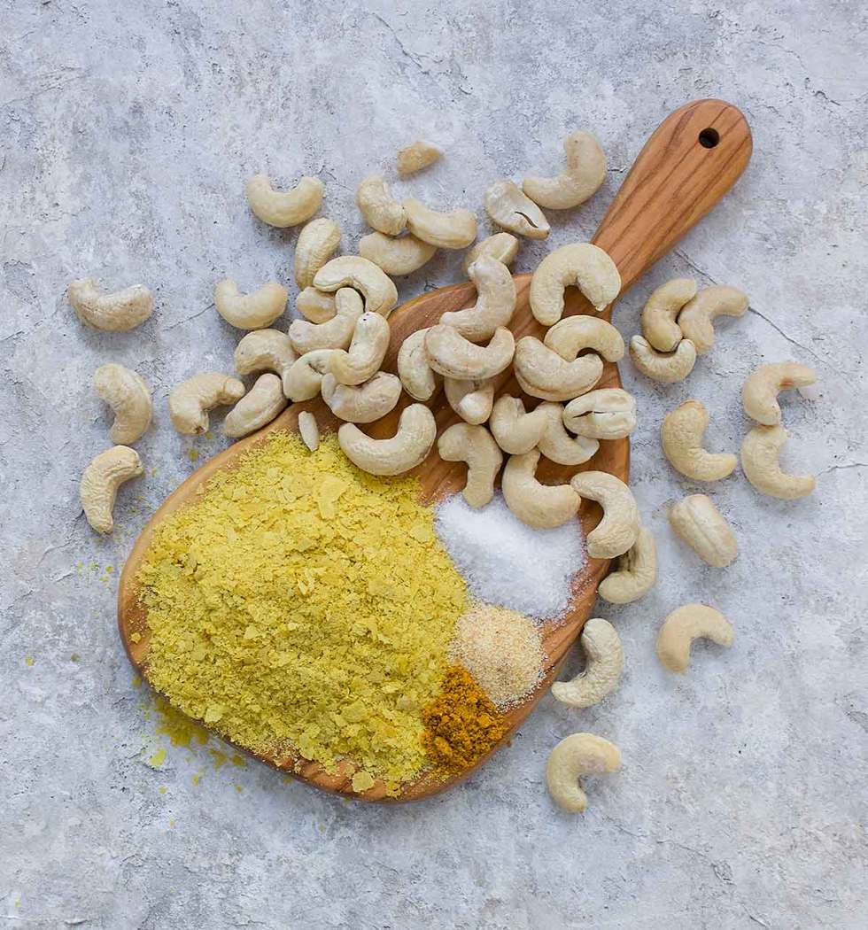 Vegan parm seasoning ingredients on cutting board.