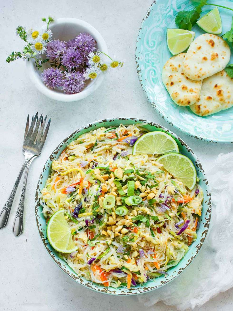 A bowl of Rainbow Pad Thai with a side of mini naans