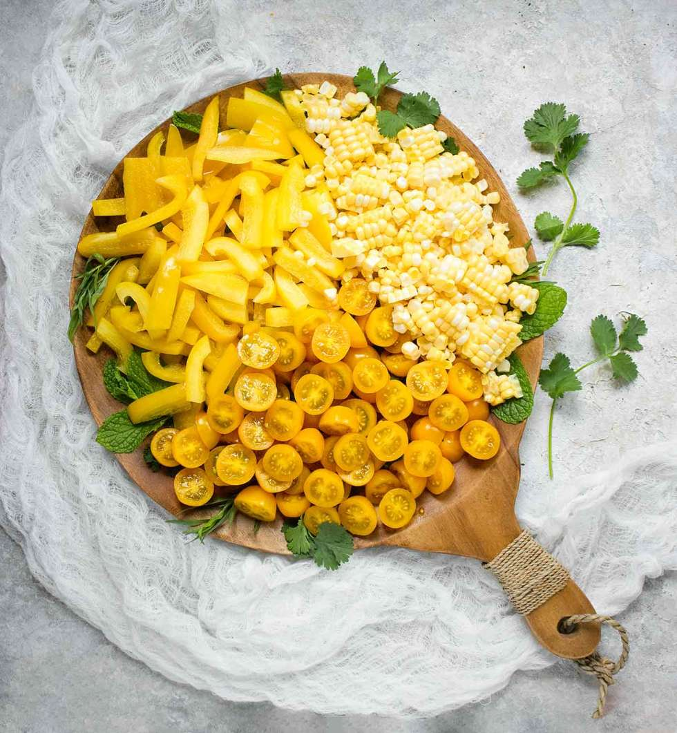 Ingredients for Yellow Gazpacho on a serving board