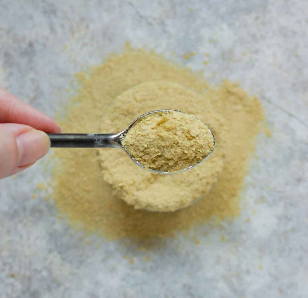 Nutritional Yeast flakes on a spoon