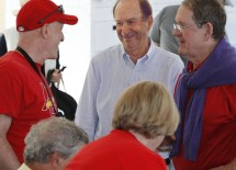 Alumni, parents and friends, including Emeritus Trustee John Wallace (right), MBA '62, mingle with Bill DeWitt Jr. (center), chairman and CEO of the Cardinals organization, before the game. (Reinhold Matay)