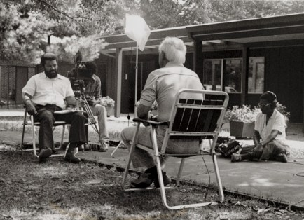 Hampton conducts an interview for one of his documentaries. (Henry Hampton Collection, Washington University Libraries, Department of Special Collections)