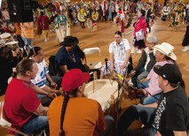 Circles form around traditional American Indian drums. The drummers keep a steady beat for the dancers. (Joe Angeles)