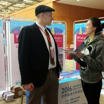 Guy M. Genin, professor of mechanical engineering and materials science in the School of Engineering & Applied Science at Washington University and in the Department of Neurological Surgery at the School of Medicine speaks to a student during the World Class Universities Expo in Xi'an. Genin serves as the McDonnell Academy Ambassador to Xi'an Jiaotong University.