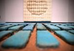 "Sam Boven, ""Filter Feeding,"" 2016. Sponges, glazed ceramic, wood, sand and spray paint. (Photo: James Byard/Washington University)"