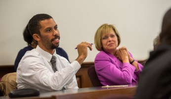 Brandon Wilson is a current Chancellor's Graduate Fellow and doctoral student in history. Patti Thorp (right) attended the faculty panel discussion as well. (Photo: Joe Angeles)
