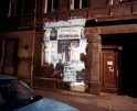 "Shimon Attie, ""Almstadtstrasse 43 (formerly Grenadierstrasse 7),"" 1992. 20""X24"" chromogenic photograph, from the project ""The Writing on the Wall."""