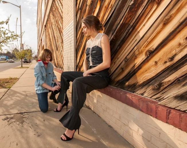 Designer Alexis Giger preps Sienna Feher of CENTRO Models. (Photo: Joe Angeles/Washington University)