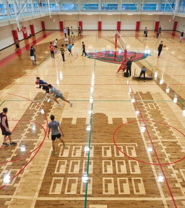 The new three-court gym will host 30 intramural sports and some 550 IM games this year. Sports range from favorites like basketball and flag football to untraditional games like bubble soccer and log rolling. (Dan Donovan/Washington University)