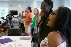 several minority students laugh together