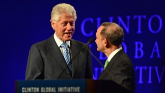 In 2013, Washington University welcomed some 1,200 students – and a former American president – to campus for the 6th annual Clinton Global Initiative. Here, Chancellor Wrighton greets President Bill Clinton at the podium.