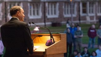 Chancellor Wrighton leads the university community in a quiet moment of reflection at a vigil in 2007 to remember the 32 victims of a mass shooting at Virginia Tech.