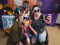 students take a selfie by Halloween display