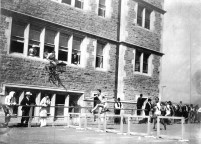 Hurdlers run past the south façade of the Olympic gymnasium. (Photo: Courtesy of Missouri Historical Society)