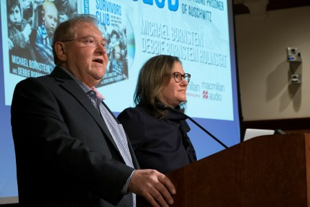 "Holocaust survivor Michael Bornstein and his daughter, Debbie Bornstein Holinstat, AB '96, delivered the Washington University Assembly Series lecture ""Survivors Club: The True Story of a Very Young Prisoner of Auschwitz"" Monday, Nov. 13, 2017, at the Bryan Cave Moot Courtroom in Anheuser-Busch Hall. (Sid Hastings/WUSTL Photos)"
