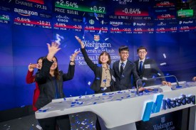 McDonnell International Scholars Academy members (from left) Clarice Hong, Zhen Tian, Jiayang Chen and Changqing Wang visit the Nasdaq floor after the closing bell during the cohort's spring trip to New York City in March 2018. (Photo: Joe Angeles/Washington University)