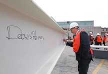 Weil Hall beam signing