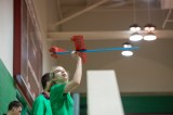 student flies glider in Field House