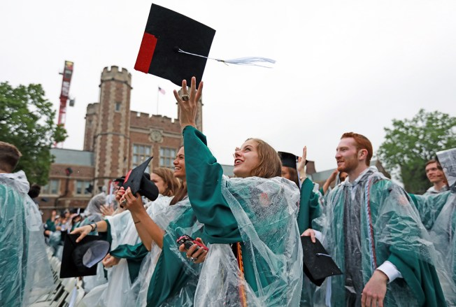 Students celebrate at Commencement May 18. (Photo: James Byard/Washington University)