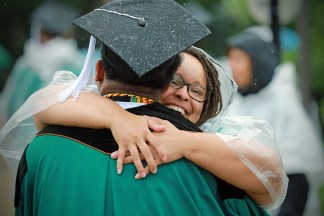 Students and loved ones celebrate at Commencement May 18. (Photo: James Byard/Washington University)