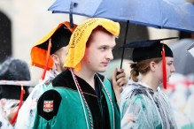 student with towel at Commencement