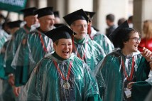 Smiling through the rain -- and the university issued poncho at Commencement May 18. (Photo: James Byard/Washington University)