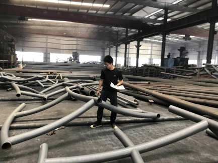 Design manager Jian Zhu, a master's candidate in architecture, at the Beilida facility in Nanjing, where steel substructures were assembled.