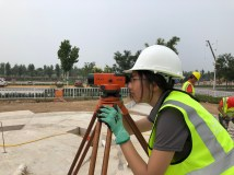 Landscape designer Lu Yu, a master's candidate in architecture, surveys the site. Yu also served as team competition manager.