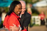 When two Olympic legends meet: Jackie Joyner-Kersee and Bill Toomey, 1968 gold-medal winner of the decathlon, greet each other before the ceremony.