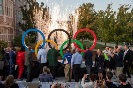 The moment of unveiling: Pyrotechnics and familiar Olympic music accompanied the debut of the sculpture. (All photos by Sid Hastings/Washington University)