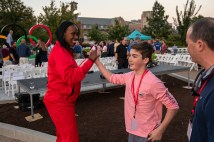 Olympian Jackie Joyner-Kersee high-fives Gregory Britt after he demonstrated his running form to the six-time Olympic medalist. The seventh-grader told his grandmother, Sharon Britt, that it was a night he'd remember his entire life.