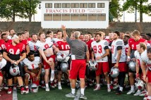 The Bears football team congratulates Coach Larry Kindbom Oct. 3 after the surprise presentation as honorary head coach of the AFCA Good Works Team. Read more about the surprise and the award on the Bear Sports website.